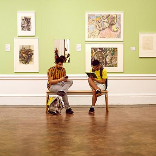 Visitors engage with artworks, and draw themselves, as part of Drawing from the Collection at the Iziko South African National Gallery.  Photograph: Marla Burger © Iziko